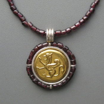 Red griffin pendant